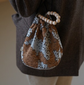 poppy bucket bag _ earth brown
